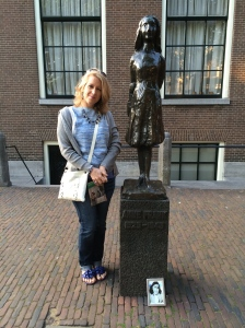 Debbie Spanberger by statue of Anne Frank, by Mari Andriessen, outside the Westerkerk in Amsterdam